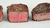 Three differently done steaks