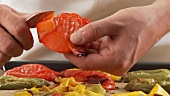 Peppers being peeled