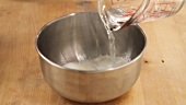 Corn flour being stirred into water
