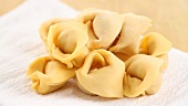 Tortellini bolognese being prepared (German Voice Over)