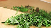 Mixed herbs being chopped
