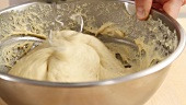 Yeast dough being kneaded with dough hooks