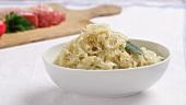 Sauerkraut mit Bauchspeck zubereiten