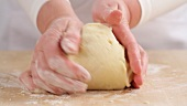 Shortcrust dough being shaped into a ball