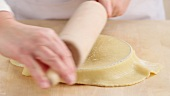 Shortcrust pastry being placed in a tart dish and the excess edge being removed