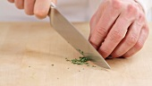 Rosemary needles being finely chopped