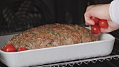 Mediterranean-style meat loaf being prepared (German Voice Over)