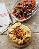 Spinach and pepper pie with pine nuts and tomato salad