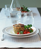 Individual courgette flan with watercress and tomato salad