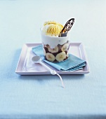 Bananas with chocolate sauce, cream and vanilla ice cream