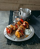 Grilled chicken skewers with yoghurt and saffron marinade