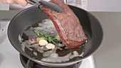 Saddle of venison being prepared with spiced butter (German Voice Over)