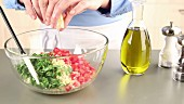Tabbouleh (Lebanese bulgur salad) being prepared