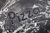 The word 'Pizza' written in flour (stop motion)