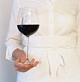 Waitress with glass of red wine