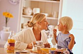 Mother and son eating breakfast