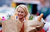 Young woman carrying bags of shopping