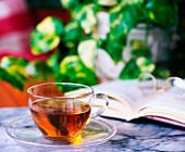 A glass cup of herbal tea