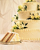 Four Tier Wedding Cake with Yellow Flowers