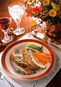 Slices of stuffed capon with vegetables and wine