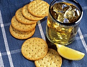 A Glass of Whiskey with a Wedge of Lemon and Crackers
