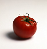 Whole tomato with top spritzed