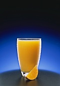 Tall Redfreshing Glass of Orange Juice; Orange Wedge