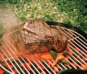 T-Bone Steak on the Grill with Vegetables; Steam