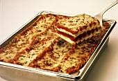 Lasagna in a Pan; a Serving on a Spatula