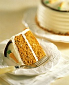 Carrot Cake Slice; Whole Cake in Background