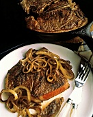 T-Bone Steak with Onions; Steak in a Skillet