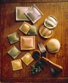 Nine Uncooked Varieties of Ravioli on Cutting Board