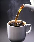 Pouring Hot Coffee into Mug