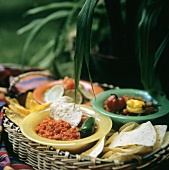 Salsa and Guacamole in Basket with Corn Chips