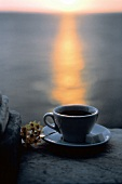 Cup of Coffee with Ocean and Sunset