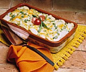 Enchiladas in Casserole Dish with Melted Cheese