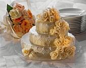 Three Tier Wedding Cake; Flowers; Plates and Cake Server