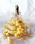 Three Tier Wedding Cake with Bride and Groom