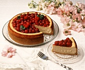 Cheesecake and slice with raspberry topping