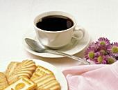 Cup of Black Coffee with Sugar Cookies