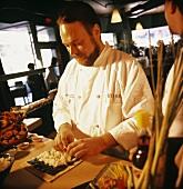 Chef Preparing Sushi in a Restaurant