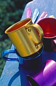 Bright Metal Coffee Cups and Spoons