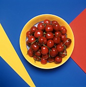 Fresh Red Cherries on a Yellow Plate