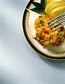 Crabmeat with diced vegetables in crab shell on plate