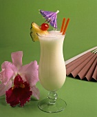A Glass of Pina Colada with Fruit and a Cocktail Umbrella