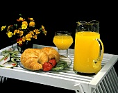 Croissants Fruit and Orange Juice on a Tray