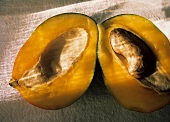 A Mango Cut in Half with Seed