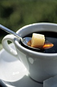 A Sugar Cube in a Cup of Coffee
