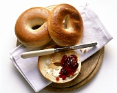 Two Bagels and a Half of Bagel with Butter and Jelly