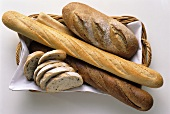 Assorted Bread Loaves and Slices in a Basket